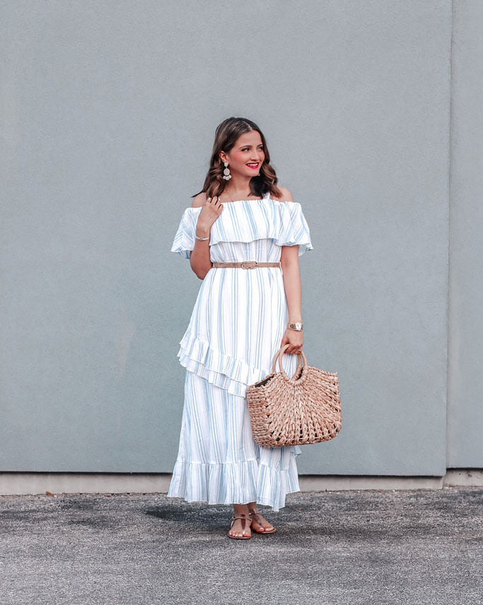 Tips on how to style a maxi dress blogger outfit - Blue and White cold shoulder maxi dress straw bag