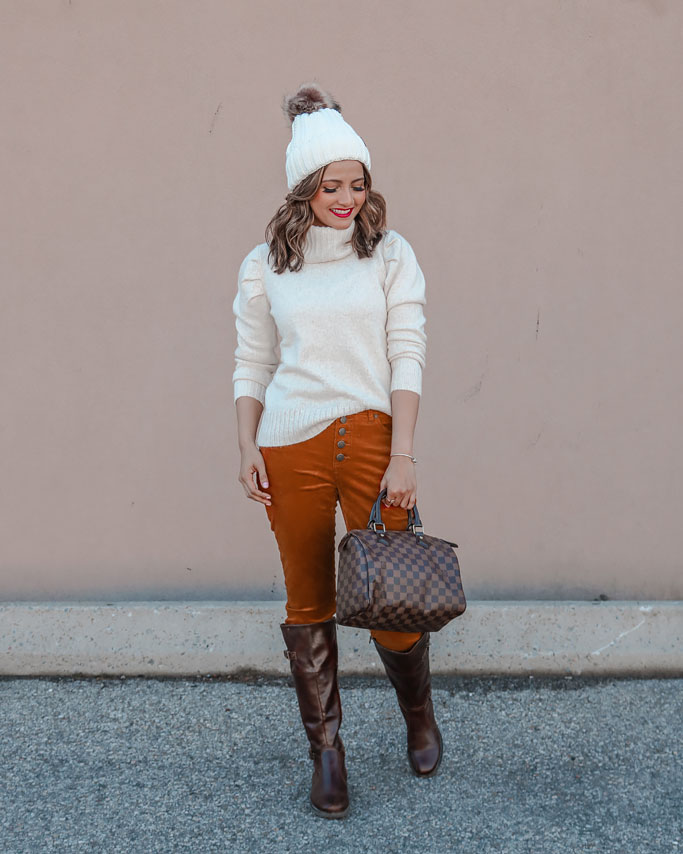 White beanie White puffed sleeve cabi tuck turtleneck caramel button fly skinny cords louis vuitton speedy 25 blogger outfit